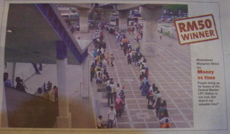TRANSIT notes the orderly queueing of the waiting passengers at the KL-Seremban bus stand. No Q-System here!