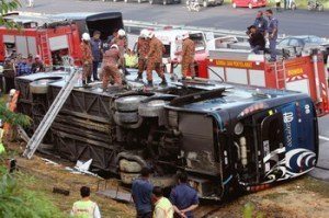 NST image of an express bus lying on its side after a crash that killed 6 people and injured more