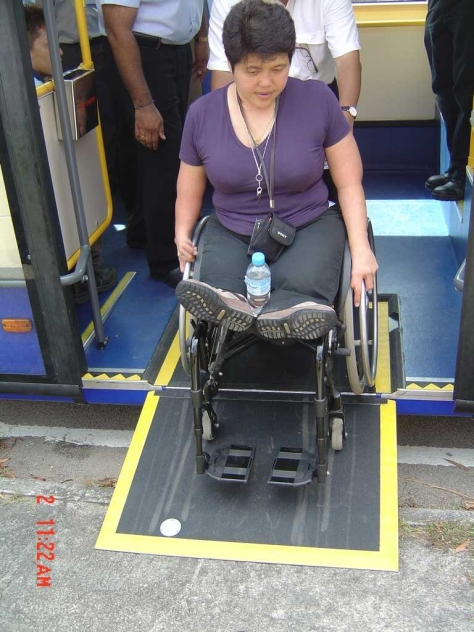 Accessibility issues consultant Judy Wee tries out the ramp in Singapore - image courtesy of Scania Malaysia / Rapid Penang