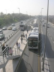 Istanbul, Turkey METROBUS running contra-flow in the centre of the highway, with simple shared platforms to reduce costs